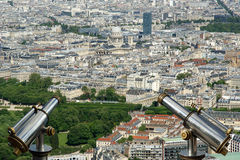 Telescope viewer and city skyline at daytime. Paris, France Stock Photos