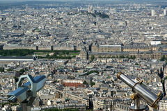 Telescope viewer and city skyline at daytime. Paris, France Stock Images