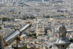 Telescope viewer and city skyline at daytime. Paris, France Royalty Free Stock Photo