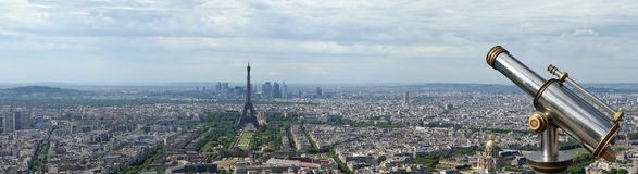 Telescope viewer and city skyline at daytime. Paris, France. Taken from the tour Montparnasse with the Eiffel Tower, Le Grande Palais, Les Halles, St. Eustace Royalty Free Stock Photo