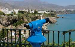 Telescope viewer overlooking from Balcon de Europa in Nerja, Andalusia, Spain Royalty Free Stock Photo