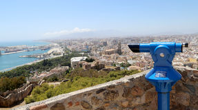 Telescope viewer overlooking the Malaga in Andalusia, Spain. Aerial view of the city Royalty Free Stock Images