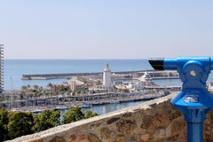 Telescope viewer overlooking the Malaga in Andalusia, Spain. Aerial view of port and the city Royalty Free Stock Images