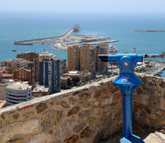 Telescope viewer overlooking the Malaga in Andalusia, Spain. Aerial view of port and the city Stock Photo