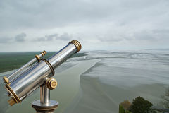 Telescope viewer and  View from Mont Saint-Michel, France. Telescope viewer and  View from Mont Saint-Michel, Normandy, France--one of the most visited tourist Stock Images