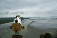 Telescope viewer and  View from Mont Saint-Michel, France. Telescope viewer and  View from Mont Saint-Michel, Normandy, France--one of the most visited tourist Stock Photo