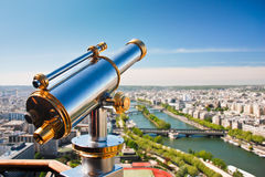 Telescope on the viewpoint with view of the Seine river and its green banks. Panoramic view of Paris in sunny weather. Telescope on the viewpoint with view of Stock Photos