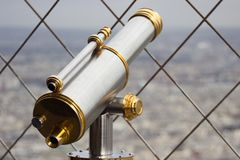 Telescope at window Royalty Free Stock Images