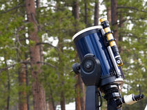 Telescope in the woods Royalty Free Stock Photos