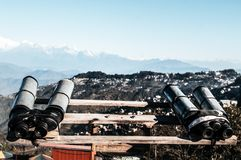 Telescopes, Binoculars, field glasses mounted for viewer to magnify binocular vision to see Kanchenjunga, Everest, Annapurna mou stock photos