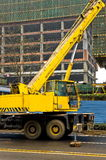 Telescopic crane control cabin and gib arm. Royalty Free Stock Photography