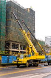 Telescopic cranes are lifting heavy weight. royalty free stock photography