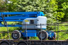 Telescopic elevator lifting equipment in transporting progress on uk motorway.  royalty free stock photos