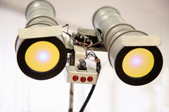 Telescopic eyes robot with yellow light Stock Images