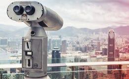 Telescopio binoculare per la città di Hong Kong Immagine Stock