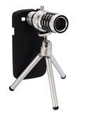 Teleskopiskt linstillbehör för en smartphone Arkivbild