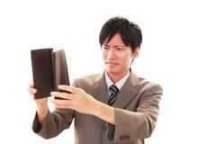 Teleurgestelde Aziatische mens stock afbeelding