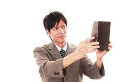 Teleurgestelde Aziatische mens stock foto's