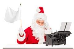 Teleurgestelde Kerstman met het typen machine golvende vlag Stock Foto