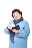 Teleurgestelde oudste met laatste bankbiljet Stock Foto's