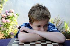 Teleurgestelde schaakspeler Stock Foto