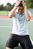 Teleurgestelde tennisspeler royalty-vrije stock afbeeldingen