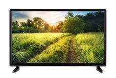 Televisão a alta definição moderna com estrada e grama verde Imagem de Stock Royalty Free