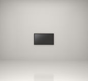Televisión con pantalla grande en el sitio blanco Foto de archivo libre de regalías