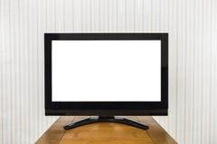 Televisión moderna en la tabla de madera con la pantalla cortada Imagen de archivo libre de regalías