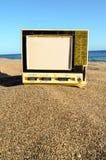 Televisie op het Zandstrand stock foto