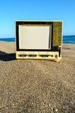 Televisie op het Zandstrand stock fotografie