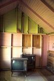Televisies in een verlaten motel Stock Foto