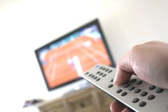 Television. Changing channels on plasma TV using remote control royalty free stock photography