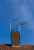 Television aerials on chimney Royalty Free Stock Image