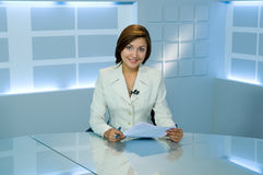 Television anchorwoman. Smiling television anchorwoman at studio during work stock images