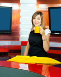 Television anchorwoman has coffee break Royalty Free Stock Image