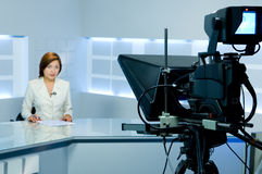 Television anchorwoman during live broadcasting. Television anchorwoman at studio during live broadcasting stock photo