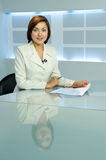 Television anchorwoman at TV studio. Smiling television anchorwoman at studio during work royalty free stock photos