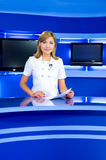Television anchorwoman at TV studio Stock Images