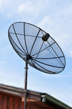 Television antenna against the afternoon sky Stock Photos