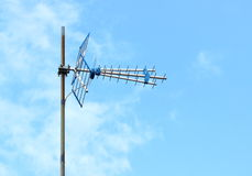Television antenna with blue sky Stock Photos