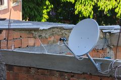 Television antenna in the shanty town royalty free stock image
