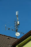 Television antenna and wi-fi transmitter Royalty Free Stock Image