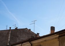 Television antennas with the old roofs view stock photos