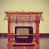 Television in a birdcage Royalty Free Stock Images
