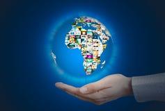 Television broadcast multimedia sphere. World globe on hand Stock Photos