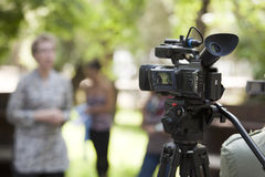 Television broadcasting. Covering an event with a video camera Royalty Free Stock Photography