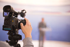 Television broadcasting. Covering an event with a video camera Royalty Free Stock Images