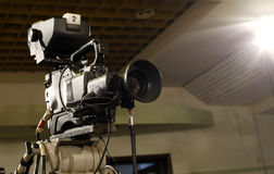 Television camera. Television camcorder in a conference room royalty free stock photos