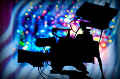 Television camera. Silhouette of a professional television camera on tripod Stock Image